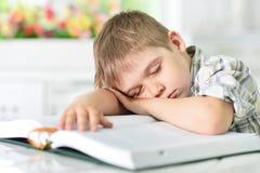 Boy sleeping on book Stock Photo