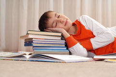Boy is sleeping on the books Stock Photo