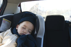 Boy sleeping in car Royalty Free Stock Images