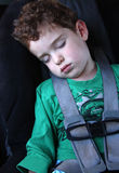 Boy sleeping in the car. Young boy sleeping in the carseat Royalty Free Stock Photos