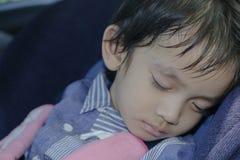 boy sleeping in child car seat Royalty Free Stock Image