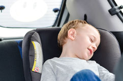 Boy  sleeping in child car seat Stock Images