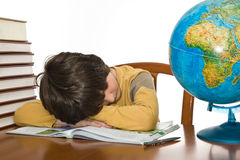 Boy sleeping while  doing homework Royalty Free Stock Photo
