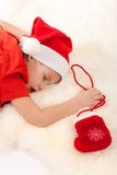 Boy sleeping and dreaming about gifts Royalty Free Stock Photo