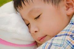 Boy sleeping in the garden Stock Photos