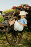 Boy sleeping in garden on the carriage Stock Photos