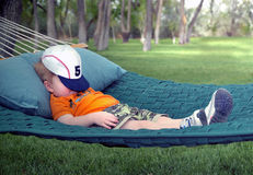Boy sleeping in hammock