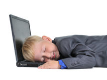 Boy sleeping on laptop tired of work Royalty Free Stock Photo