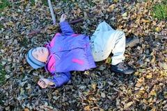 Boy sleeping on leaves Stock Photos