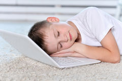 boy sleeping near and  laptop Stock Images