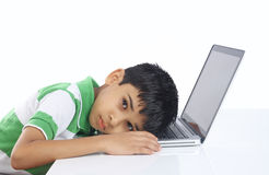 Boy Sleeping over the laptop Stock Photos
