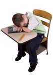 Boy sleeping at school desk Stock Photos
