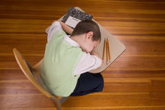 Boy sleeping at school desk Royalty Free Stock Images
