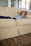 Boy sleeping on sofa in the living room Royalty Free Stock Photos