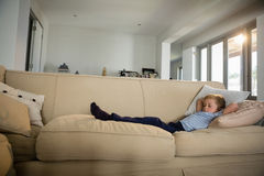 Boy sleeping on sofa in the living room Royalty Free Stock Photo