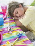 Boy Sleeping At Table After Birthday Party Stock Photos