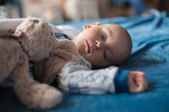 Boy sleeping with teddy bear. Cute baby boy sleeping with teddy bear Royalty Free Stock Image