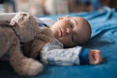 Boy sleeping with teddy bear Royalty Free Stock Image
