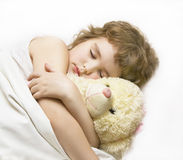 Boy, sleeping with toy bear Stock Photography