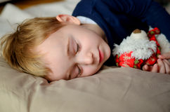 Boy  sleeping  with toy Royalty Free Stock Photo