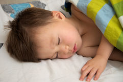 Boy sleeping under blanket Royalty Free Stock Image