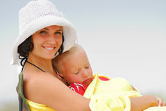 Boy sleeping on young adult mother Royalty Free Stock Photography