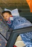 The boy sleeps on the bus royalty free stock photography