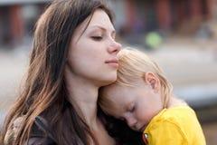 The boy sleeps on mom. Stock Image