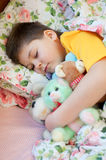 Boy sleeps with soft toys Royalty Free Stock Images