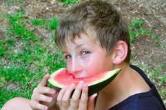 A boy with a slice of watermelon Stock Photos