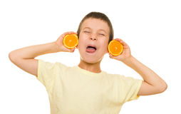 Boy with sliced orange having fun Royalty Free Stock Photo