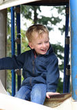 Boy on a slide Royalty Free Stock Images