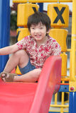 Boy on slide. Boy playing on the slide Royalty Free Stock Photography