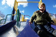 Boy on slide Royalty Free Stock Photography