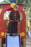 Boy on a slide Stock Photo