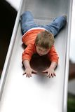 Boy on slide Royalty Free Stock Photo