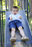 Boy on a slide Stock Photos