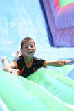 Boy on slide. Boy slidingdown water shoot Royalty Free Stock Image
