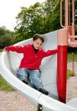 Boy on a slide Stock Photos