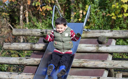 Boy on slide Stock Image