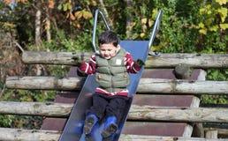 Boy on slide Stock Image