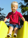 Boy on slide. A young boy gets ready to slide Royalty Free Stock Image
