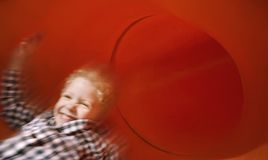 Boy on slide in motion Royalty Free Stock Photography