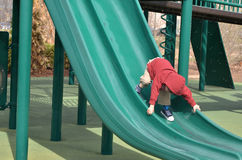 Boy on a slide Stock Image