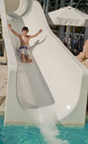 Boy on slide at waterpark Royalty Free Stock Photo