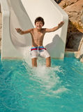 Boy on slide at waterpark Royalty Free Stock Image
