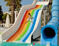 Boy on slide at waterpark Royalty Free Stock Images