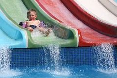 The boy slides a waterslide. Stock Photography