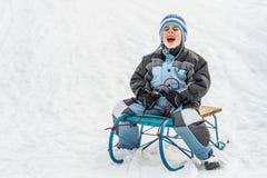 Boy sliding Royalty Free Stock Image