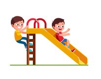 Free Boy Sliding Down Slide And Climbing Up Ladder Stock Image - 159189251